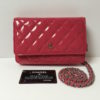 Chanel WOC in Pink diamond quilted Patent Leather with silver hardware.