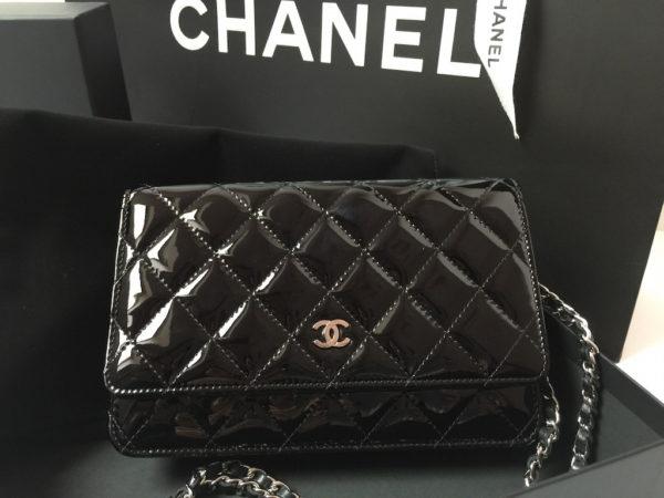 70e57dc7ac58 Chanel WOC Black Patent Leather Chanel handbags Designer handbags Luxury  bags