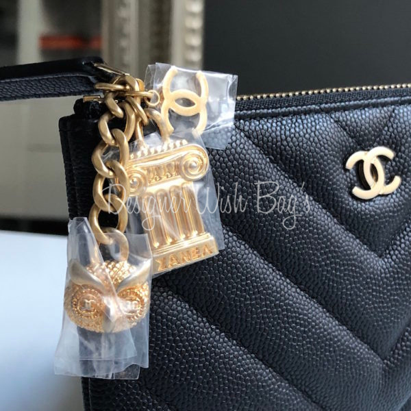 4db7bbebc3d7 Chanel Small O Case Charms Cruise -